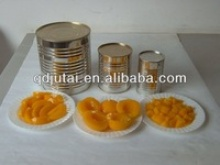 canned apricot halves with fresh raw material apricot fruit - product's photo