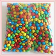 sugar coated hard dragees m&m candy like chocolate beans - product's photo