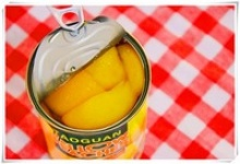 canned yellow peach in syrup - product's photo