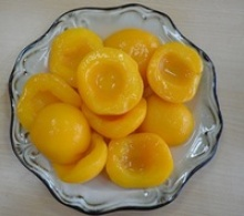 canned yellow peach halves in syrup - product's photo