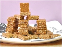 peanut chikki - traditional indian made sweet peanut candy - product's photo