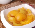 canned yellow peach in halves and strips - product's photo