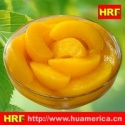 canned yellow peach slices - product's photo