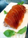 frozen cooking skin-on roasted duck - product's photo