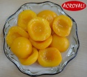 canned peach halves in syrup in 425 tins - product's photo